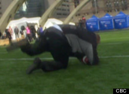 Rob Ford, Toronto's football-loving mayor, made an on-camera fall at a press event on Tuesday that has gone viral on websites around the world. (CBC)
