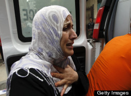 The mother of Palestinian boy Abdel Rahman Majdi Naim cries after her son was killed in strike on the building housing AFP's offices in Gaza City on November 21, 2012.