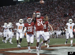 Oklahoma running back Brennan Clay celebrates after scoring the game winning touchdown against Oklahoma State in overtime of an NCAA college football game in Norman, Okla., Saturday, Nov. 24, 2012.