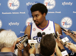 Philadelphia 76ers' Andrew Bynum answers questions about his injury during their NBA basketball media day at the team's practice facility, Monday, Oct. 1, 2012, in Philadelphia. Bynum will sit out three weeks as a precaution after receiving knee treatment in Germany.