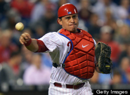 Carlos Ruiz #51 of the Philadelphia Phillies makes a throw to first base during the game against the Washington Nationals at Citizens Bank Park on September 25, 2012 in Philadelphia, Pennsylvania.