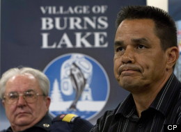 Burns Lake Fire Department Chief Jim McBride, left, looks on as Albert Gerow, Chief of Burns Lake Band, right, pauses for a moment during a news conference as he responds to the explosion at Babine Forest Products mill in Burns Lake, B.C. Saturday, Jan. 21, 2012. (THE CANADIAN PRESS/Jonathan Hayward)