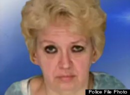 Mary Lou Petrucci is accused of animal hoarding and holding a 72-year-old man captive, police say.