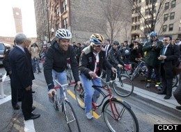Mayor Rahm Emanuel stands by as professional cyclist Christian VandeVelde and his father are the first to try out the city's very first two-way bike lanes that opened in the Loop on Dearborn Friday. (CDOT)