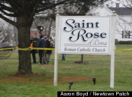 Tons of officials swarm St. Rose of Lima Church in Newtown Sunday following an anonymous threat that prompted an evacuation in the middle of a Mass. It was intended to honor the victims of Friday's shooting.