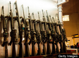 A wall of semi-automatic rifles is seen at the National Rifle Association's Annual Meetings and Exhibits on April 14, 2012 in St. Louis, Mo. (Karen Bleier/AFP/Getty Images)