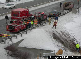 Emergency crews respond to a tour bus crash along an icy Oregon highway. (Oregon State Police)