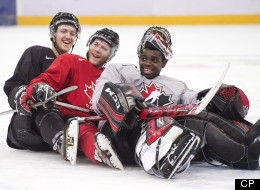 Team Canada teammates Dougie Hamilton, left, Anthony Camara, centre, and Malcolm Subban, right, ham it up for the cameras, pretending to bobsleigh during practice at the IIHF World Junior Championships in Ufa, Russia on Saturday, Dec. 29, 2012. THE CANADIAN PRESS/Nathan Denette