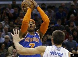 New York Knicks' Carmelo Anthony takes a shot over Orlando Magic's Nikola Vucevic (9) during the first half of an NBA basketball game, Saturday, Jan. 5, 2013, in Orlando, Fla. (AP Photo/John Raoux)
