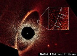This false-color composite image, taken with the Hubble Space Telescope, reveals the orbital motion of the planet Fomalhaut b. Based on these observations, astronomers calculated that the planet is in a 2,000-year-long, highly elliptical orbit.