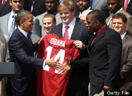 U.S. President Barack Obama (L) shakes hands with defensive lineman Damion Square (R) as offensive lineman Barrett Jones (2nd R) of the Alabama Crimson Tide at the White House on April 19, 2012 in Washington, D.C. (Photo by Alex Wong/Getty Images)