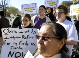 Diana Saravia, 10, of Beltsville, Md., left, demonstrates along with members of immigration rights organizations, including Casa in Action and Maryland Dream Act, demonstrate in front of the White House as they call on President Barack Obama to fulfill his promise of passing comprehensive immigration reform, in Washington, Thursday, Nov. 8, 2012. (AP Photo/Cliff Owen)
