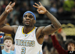 Denver Nuggets guard Ty Lawson reacts after hitting a three-point basket as time ran out in the third quarter of the Nuggets' 113-98 victory over the New Orleans Hornets in an NBA basketball game in Denver, Friday, Feb. 1, 2013. (AP Photo/David Zalubowski)