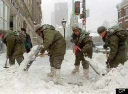 Members of the Royal Canadian Regiment shovel snow in downtown Toronto Friday, Jan.15, 1999. THE CANADIAN PRESS/Kevin Frayer