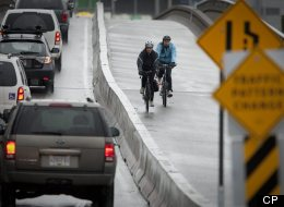 Cyclists rides across the new two-way bike lane separated from traffic on the Dunsmuir Viaduct in Vancouver in this March 10, 2010 file photo. One person has been killed and three others have been injured in a crash on the road (John Lehmann/Globe and Mail)