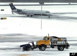 Major snowstorms in Ontario and parts of the United States have led to hundreds of cancelled flights and numerous delays. (AP)