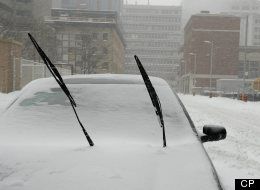 February 8, 2013. Toronto, Canada. Biggest snow storm in five years turning a busy Toronto Downtown into a winter wonderland. A parked car with windshield wipers lifted up in anticipation of a heavy snow or freezing temperatures to make scraping the windshield easier. (CP/Dominic Chan)