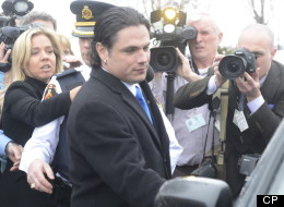 Sen. Patrick Brazeau enters a vehicle on Parliament Hill in Ottawa, Tuesday, Feb.12, 2013. Senators have voted to force Brazeau, who is facing criminal charges, to take a leave of absence from the upper chamber. (CP)