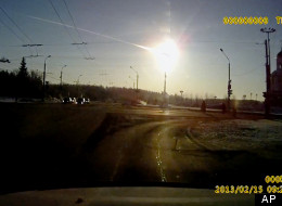 In this frame grab made from a video done with a dashboard camera a meteor streaks through the sky over Chelyabinsk, about 1500 kilometers (930 miles) east of Moscow, Friday, Feb. 15, 2013. A meteor that scientists estimate weighed 10 tons (11 tons) streaked at supersonic speed over Russia's Ural Mountains on Friday, setting off blasts that injured some 500 people and frightened countless more. (AP Photo/AP Video)