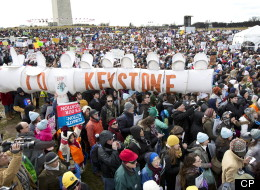 """Protestors gather at the National Mall in Washington calling on President Barack Obama to reject the Keystone XL oil pipeline from Canada, as well as act to limit carbon pollution from power plants and """"move beyond"""" coal and natural gas, Sunday, Feb. 17, 2013. (AP Photo/Manuel Balce Ceneta)"""